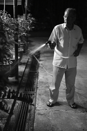 Hussien watering plants at night