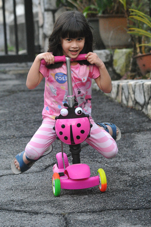 Nur Eryna playing on her skateboard